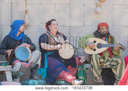 Participants Wearing Typical Clothes, Singing And Playing
