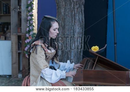 Participant Wearing Period Clothing, Playing Piano