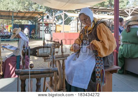 Women In Vintage Clothes Working With Fabric
