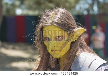 Participant Wearing Mask During The Renaissance Pleasure Faire.