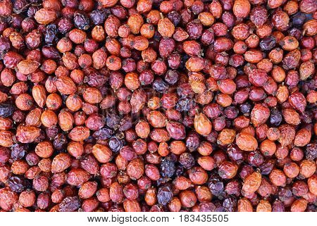 Closeup dried red hawthorn background texture fruits