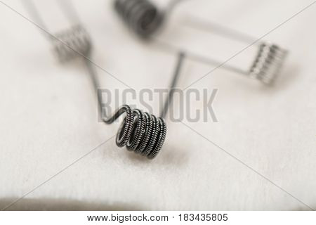 Clapton Coil Is On A White Cotton Background Blurred Coils