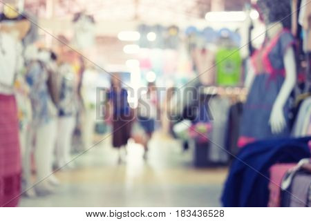 Blurred image of retail store in shopping mall for background.