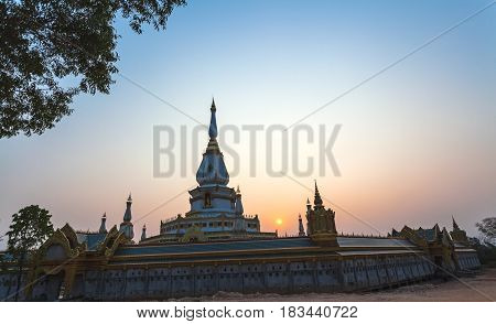 Silhouette of The Buddha Statue in Phra Maha Chedi Chai Mongkol Temple in Roi Et Thailand ( Generality in Thailand and kind of art decorated in Buddhist church temple pavilion temple hall . They are public)