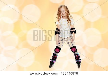 Beautiful, chubby little girl with long, blond, curly hair.Girl riding roller skates in protective gear.Brown festive, Christmas background with white snowflakes, circles.