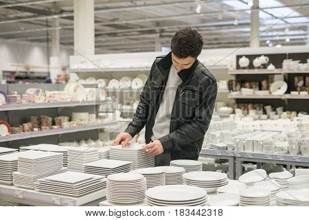 male customer choosing utensil dishes in the supermarket mall
