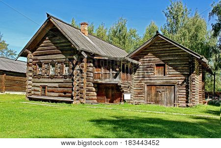 Village Street in the summer. Wooden log huts in the Russian village. Old wooden houses - monument of ancient Russian architecture. Golden ring of Russia, Kostroma