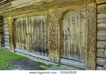 The gate to the courtyard, fragment. Woodcarving. Russian village. Old wooden houses - monument of ancient Russian architecture. Golden ring of Russia, Kostroma