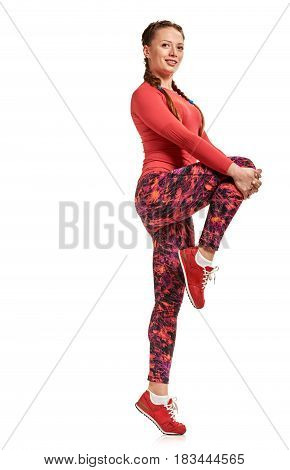 Young fit woman in sportswear doing stretching exercises