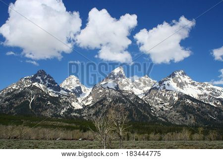Clouds positioned perfectly over the Teton mountains.