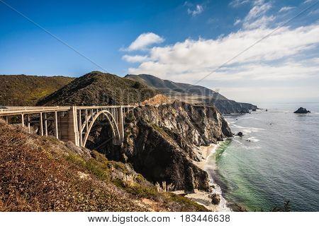 Scenic arch bridge - viaduct runs along the Pacific coast. California State Route 1. USA