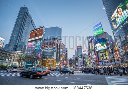TOKYO JAPAN - MARCH 30 2017 : people waiting for cross the road on pedestrians crosswalk at Shibuya district in Tokyo Japan. Shibuya Crossing is one of the busiest crosswalks in the world.