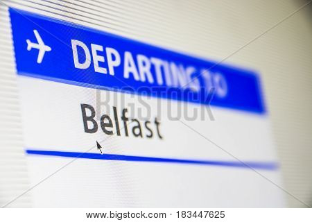 Computer screen close-up of status of flight departing to Belfast, Northern Ireland, UK