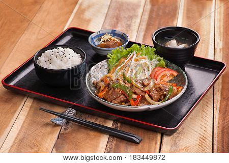 Japanese Meal Tray With Rice, Soup And Sauteed Beef With Salad