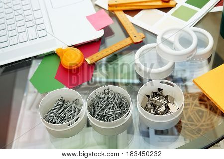 Paper clips with ruler in the office of modern designer