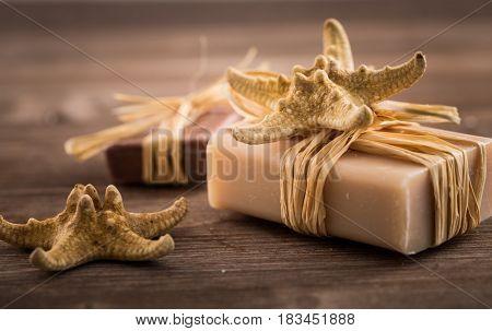 Bars of handmade soap on wooden background