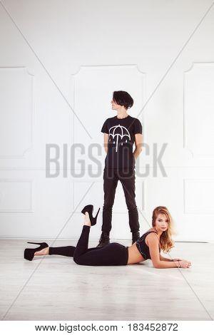 couple in black cloth near white wall