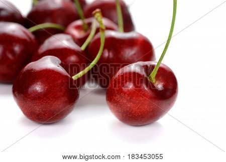Sweet cherry berries isolated on white background