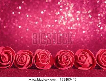 Mother's day red background roses border on a glitter blurred texture vintage style