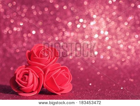 Mother's Day card three roses on a red glitter texture background vintage style blur effect