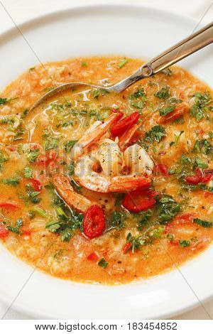 Hearty Tomato Soup With Prawns In White Platter