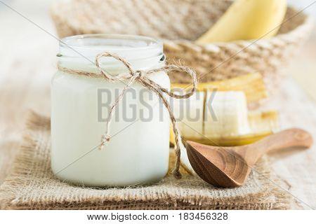 Yogurt in glass bottles on wooden table