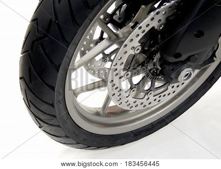Brake disc and calipers on the front wheel of sport motorcycle stock photo
