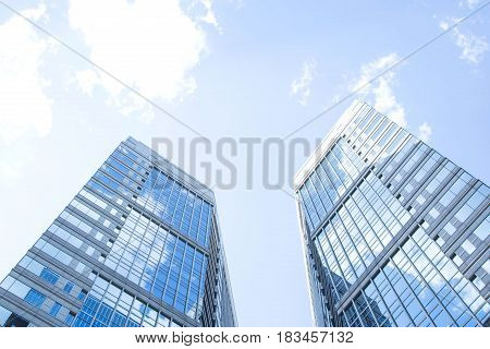 Business buildings against  blue sky. Concepts of financial and future.