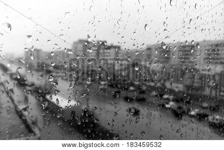 Rain on the window rain on the window outside the city window in the city rain. Black and white picture of the rain