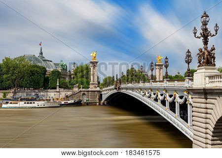 View of famous Alexander the III bridge over Seine river in Paris, France.