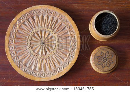 The old house the table the items on it. Round objects woodcarving. Wooden box with tea.