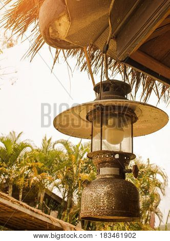 Old retro hurricane lamp hanging at outdoor