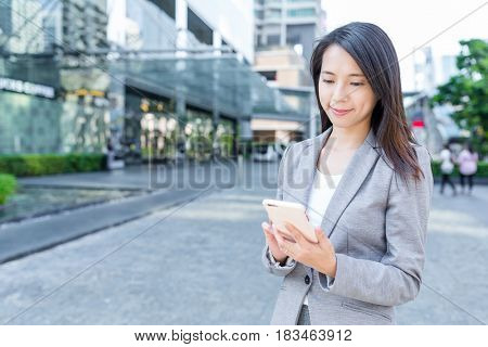 Professional business woman using mobile phone