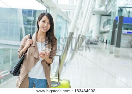 Woman enjoy using cellphone in airport