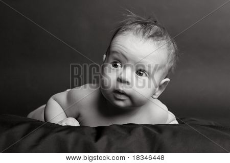 two-month child on a black background
