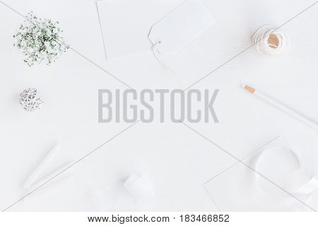Workspace with paper blank gypsophila flowers pencil. Wedding concept. Flat lay top view