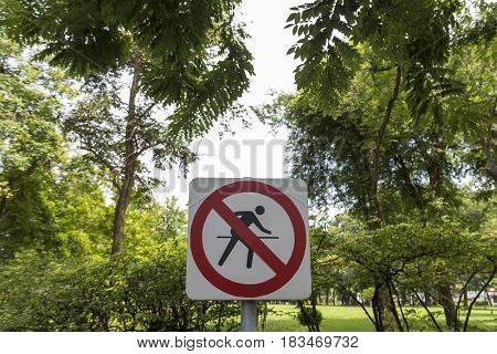 no running sign in tree background in public park Bangkok Thailand