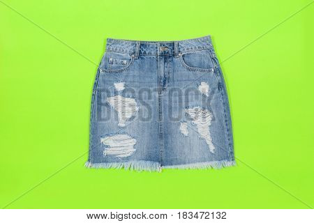 Blue denim skirt,shorts isolated on pink and green background