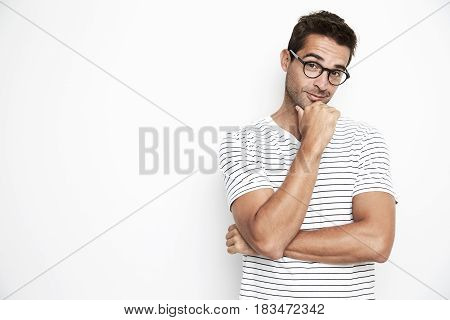Portrait of guy in glasses thinking - white background