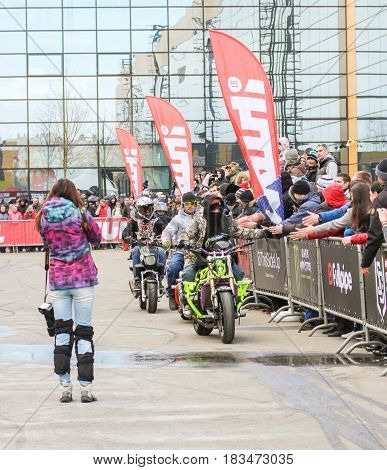 St. Petersburg Russia - 15 April, Bikers are passing along the spectators,15 April, 2017. International Motor Show IMIS-2017 in Expoforurum. Sports motorcycle show of bikers on the open area.