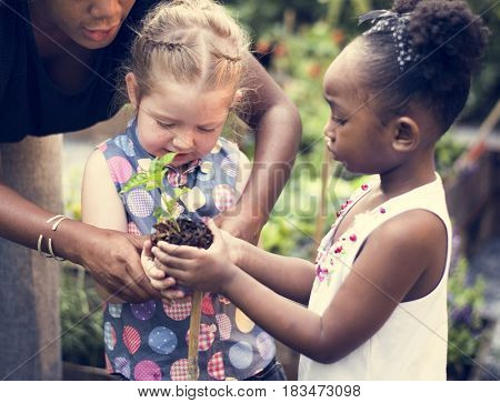 Child is going to plant a tree