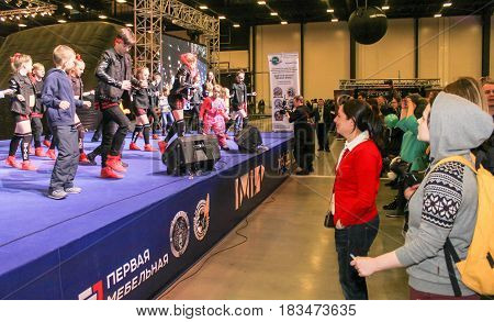 St. Petersburg Russia - 15 April, Dancers and spectators at the stage,15 April, 2017. International Motor Show IMIS-2017 in Expoforurum. Dance show group of teenagers in the style of hip-hop.
