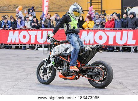 St. Petersburg Russia - 15 April, The biker is riding backwards to the front,15 April, 2017. International Motor Show IMIS-2017 in Expoforurum. Sports motorcycle show of bikers on the open area.