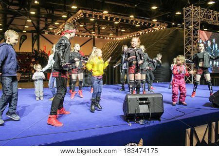 St. Petersburg Russia - 15 April, A teenager with children dancing hip hop,15 April, 2017. International Motor Show IMIS-2017 in Expoforurum. Dance show group of teenagers in the style of hip-hop.