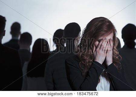 Woman Crying In Crowd