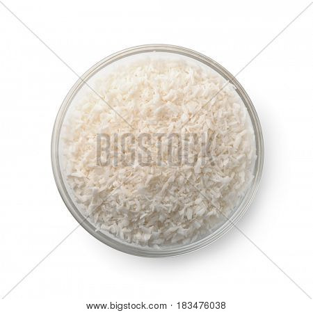 Top view of glass bowl with coconut shavings isolated on white