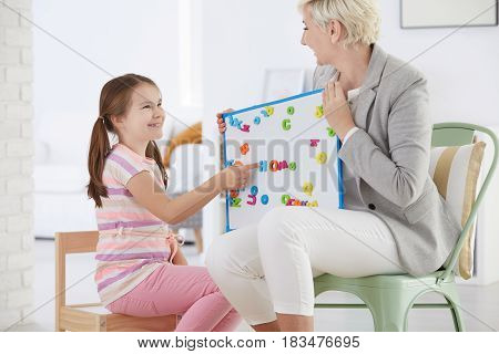 Woman Holding Whiteboard With Letters