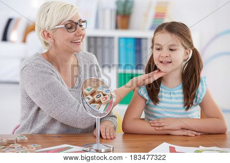 Therapist Touching Girl's Chin