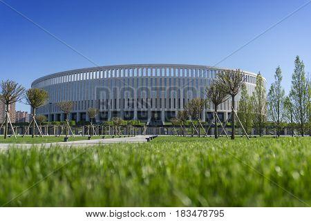 Krasnodar, Russia - April 26, 2016: Park green trees in front of the new stadium of FC Krasnodar on April 26, 2017