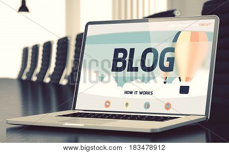Blog on Landing Page of Laptop Screen. Closeup View. Modern Meeting Hall Background. Blurred. Toned Image. 3D Illustration.